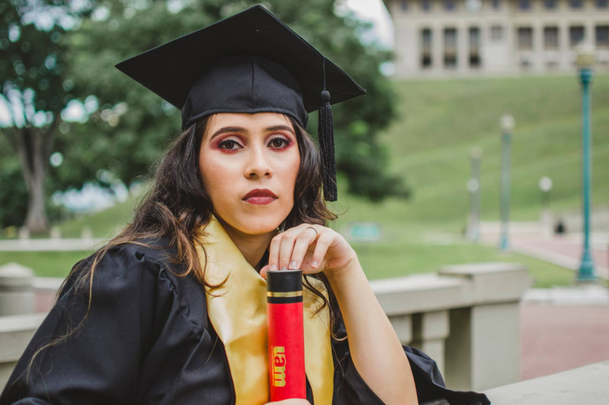 Canva - Woman Graduatin
