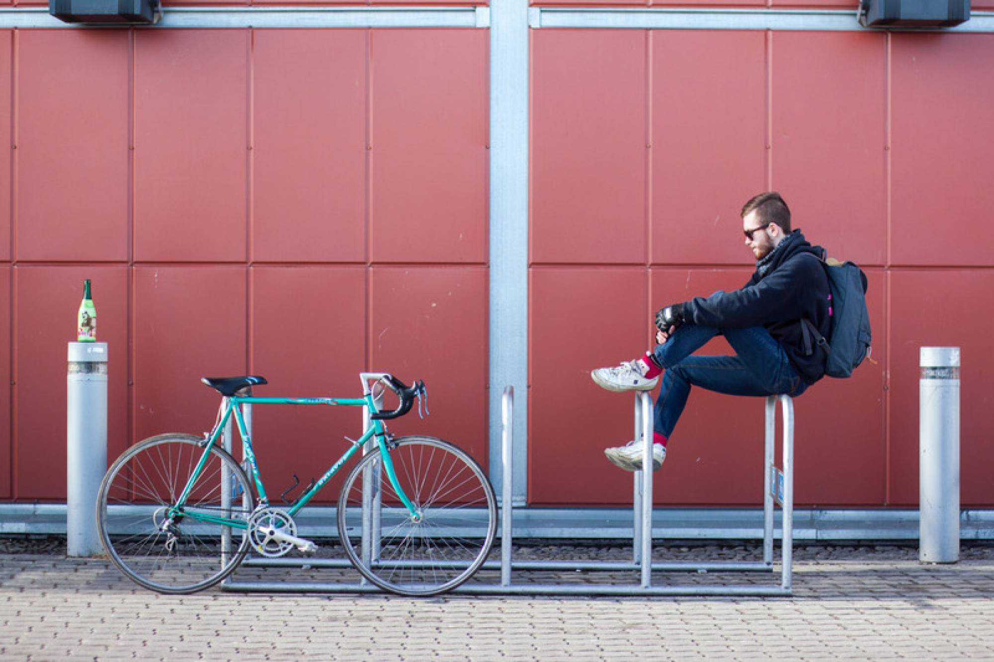 Canva - Man Sitting on White Bicycle Parking Space
